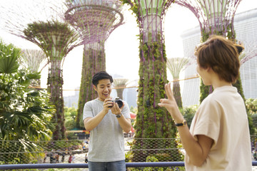 Young tourists taking photos of nature at Gardens by the Bay, Singapore