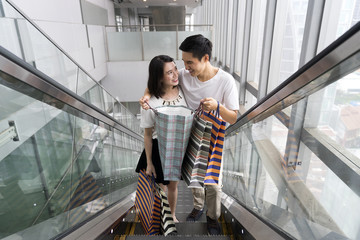Young Chinese Couple out shopping