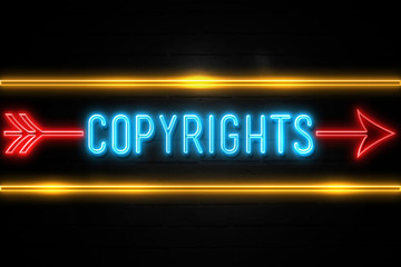 Copyrights  - fluorescent Neon Sign on brickwall Front view