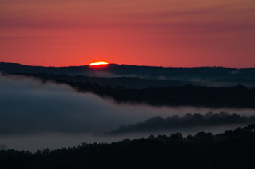 The start of a colorful sunrise over the foggy valleys near Heflin, Alabama, USA