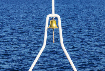 A small metal bell of a boat