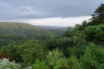 A morning view of rain in the distance from an overlook in the Talladega National Forest near Oxford, Alabama.
