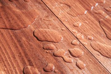 water drops on wooden board
