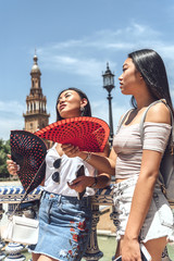 Chinese women waving fans