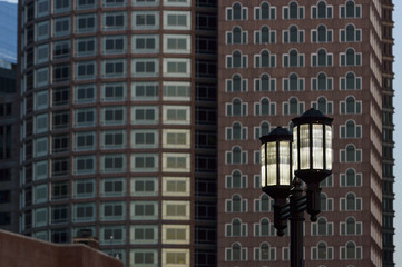 Street lamps against buildings