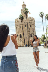 Chinese girls making photo standing outside