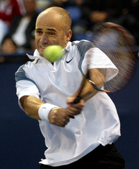 ANDRE AGASSI RETURNS BACKHAND TO MAX MIRNYI OF BELARUS.