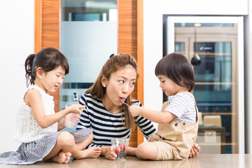 Mother Enjoying Fruit With Kids