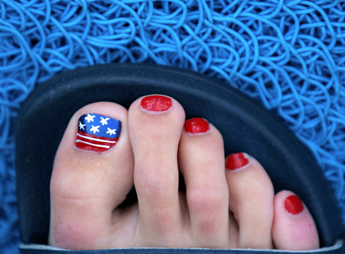 SWIMMER PAINTS US FLAG ON TOE NAILS AT US OLYMPIC SWIMMING TRIALS.
