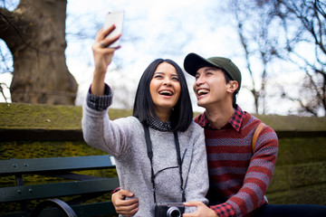 Happy couple taking a selfie in Central park