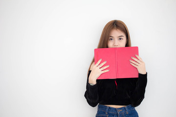Portrait of thai adult beautiful girl reading red book