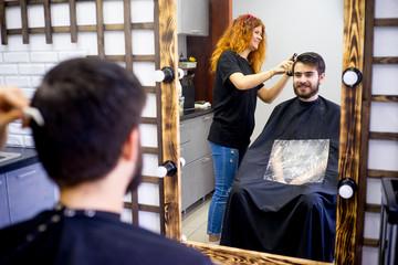 Barber dressing hair