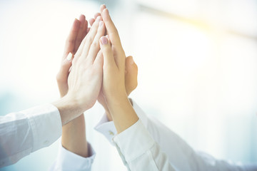 The four hands greeting with a high five