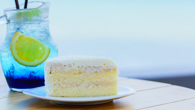 Delicious creamy homemade coconut cake on wood table
