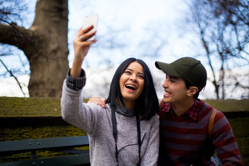 Cheerful couple taking a selfie in Central Park