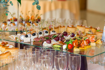 Delicacies and snacks at the Banquet. The buffet celebration. Restaurant catering. Table setting at the reception.