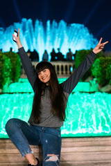 Asian young girl in the magic lights of montjuic, Barcelona