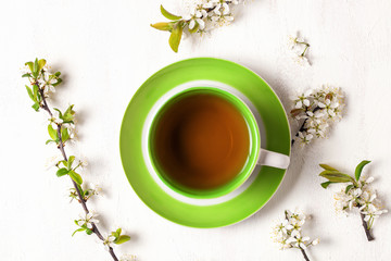 Tea and flowers of cherry