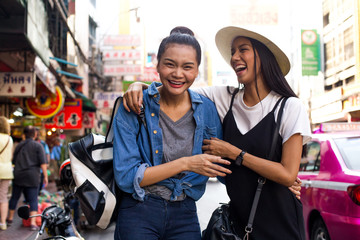 Happy Girlfriends are hanging out on the street in chinatown, Bangkok