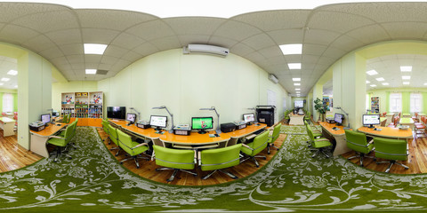 Panorama in interior modern computer class for children. Full spherical 360 by 180 degrees seamless panorama in equirectangular equidistant projection. VR content