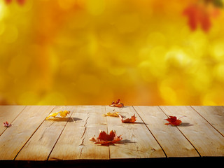 Colorful maple leaves on wooden  table.Falling leaves natural background .Autumn season concep