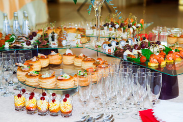 Snacks, fish and meat specialities on the buffet. Desserts. A gala reception. Served tables. Catering.