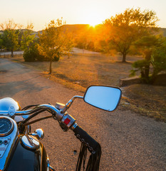 Motorcycle on a country road at sunset