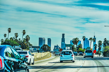 Traffic in Hollywood freeway with downtown L.A. in the background