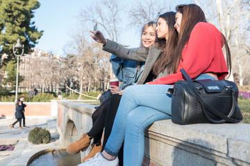 Friends taking a selfie at a Retiro Park