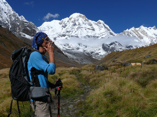 Man smoke pipe under the mountains - Beautiful day in Annapurna Base Camp
