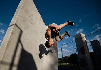 Young boy parkour a jump