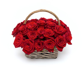 Red roses in a wicker basket