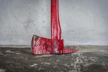instrument crime axe in puddle blood