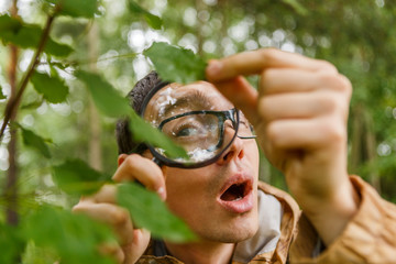 Picture of young botanist with magnifying glass