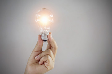 concept light bulb in hand woman showing