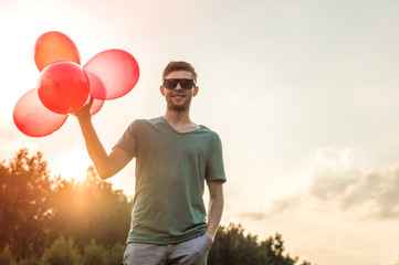 the young man with balloons. Concept happiness