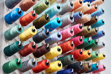 Bobbins with colored thread for industrial textile