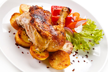 Roast chicken leg with chips on white background