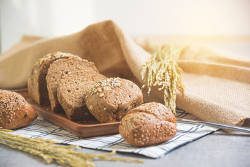 Homemade bread and wheat on table at kitchen