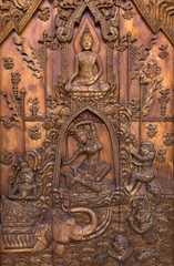 Wood carving of Buddhist history.