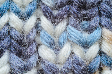Melange blue knitting texture close-up. Macro snapshot texture of knitted fabric
