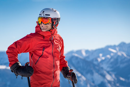 Portrait of a happy male skier in the alps
