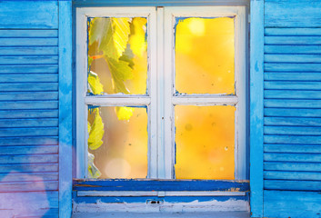 Beautiful vintage Greek window with blue shutters. Typical Greek picture.