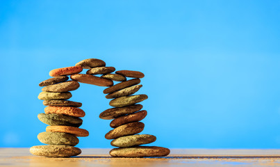 Zen stones stack on blue background