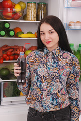 Young girl holding cola