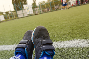 Close up sports sneakers shoes on artificial green grass