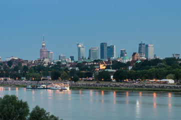 Fototapete - Evening panorama of Warsaw Vistula river waterfront and downtown skyline