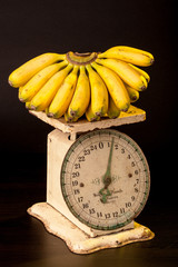 Bananas on antique scale