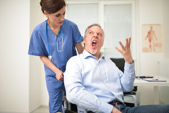 Angry disabled patient and a nurse