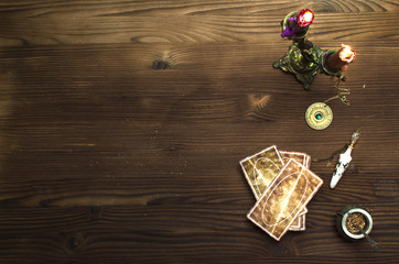 Tarot cards on wooden table. Fortune teller table..